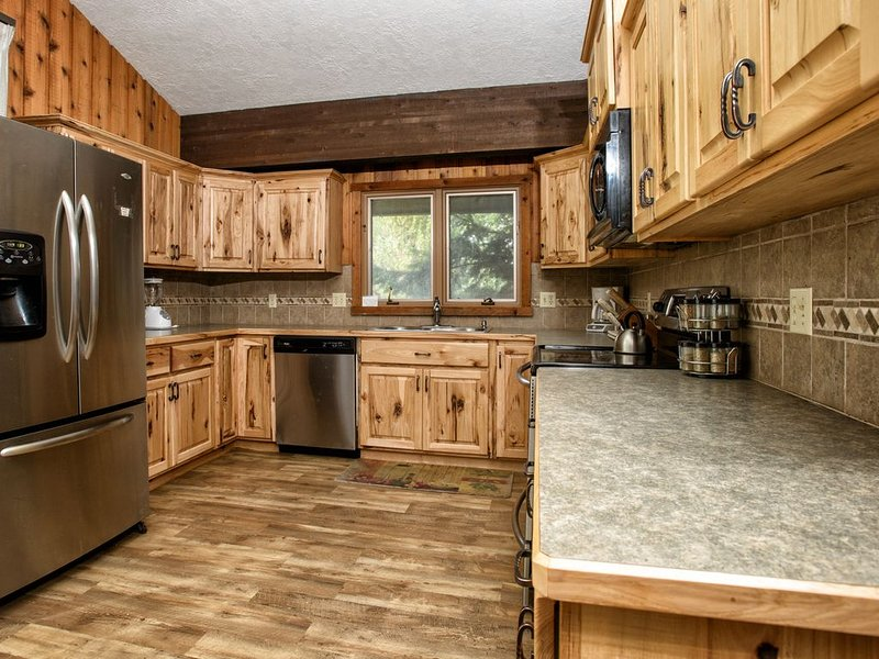 Enjoy a bit of luxury in the wilderness in the fully equipped kitchen with stainless appliances.