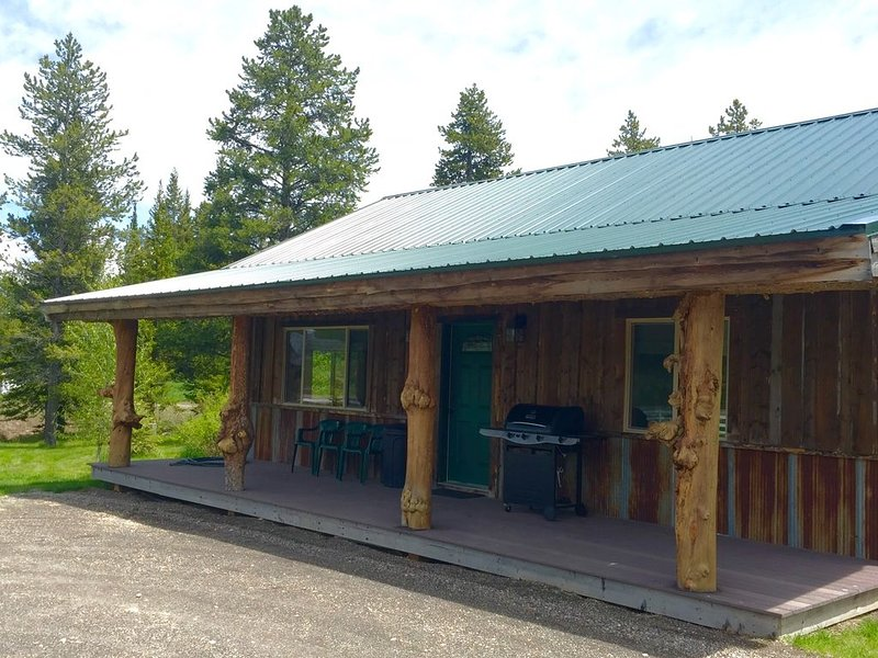 Get ready to relax on Creekside Cabin's front porch while grilling out and admiring the view!