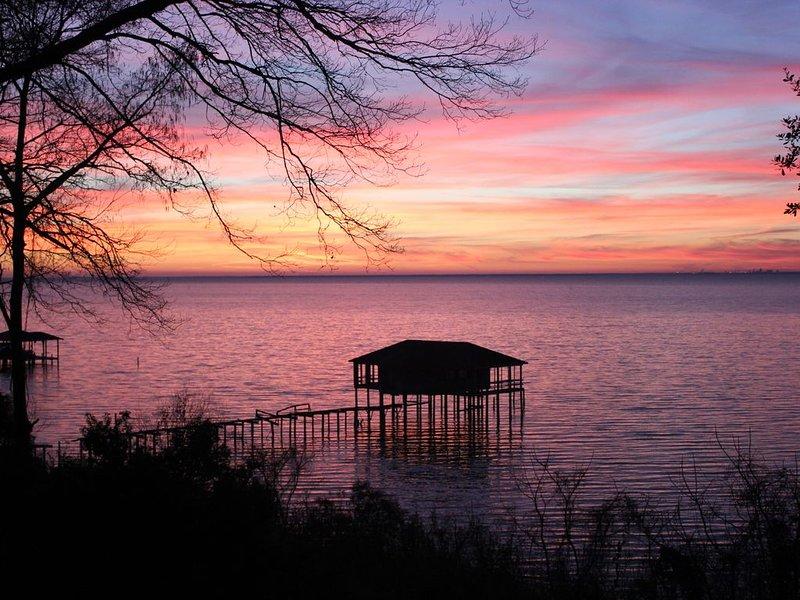 Winter sunset over Mobile Bay from upper terrace.