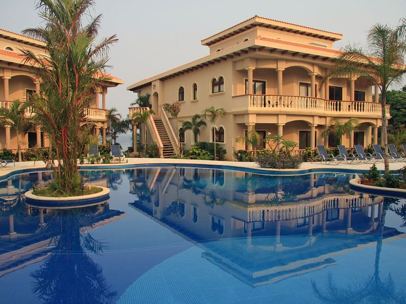 Walk down from the front door to cool off in a beautiful pool and jacuzzi