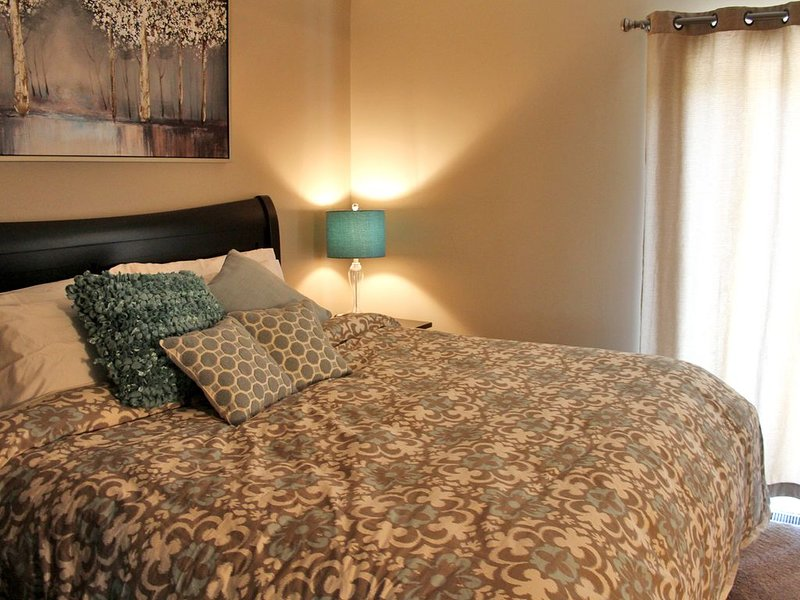 Master suite featuring a king bed.