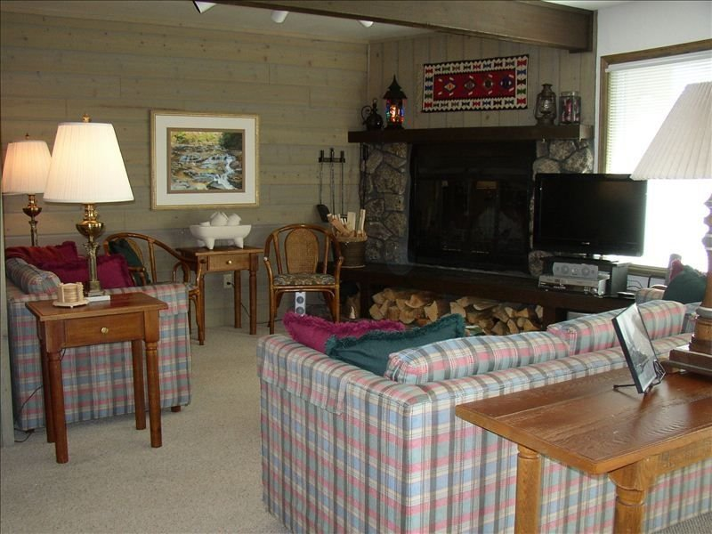 Spacious Living Room w/wood burning Fireplace, ample seating, &  HD TV