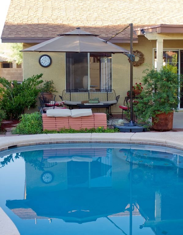 From the diving board! Uncovered patio or umbrella up - Relaxing gathering spot.