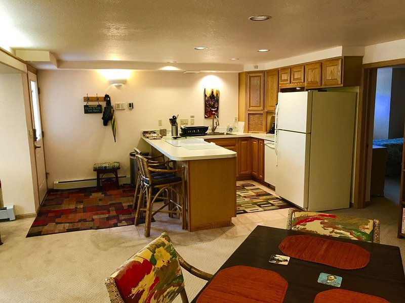 Private entrance, complete kitchen with glass top range, dinning area.