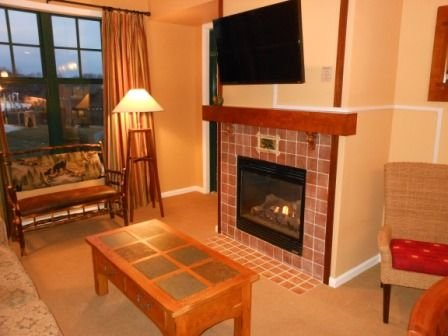Living Room with 42' LED TV over gas fireplace and Queen Sofa-bed.