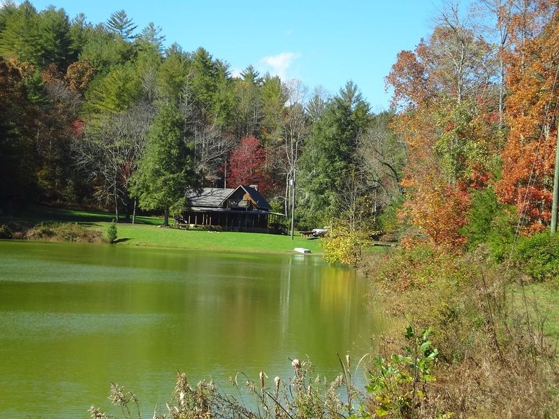 The autumn view from across the pond shows the beauty of lakeside solitude.