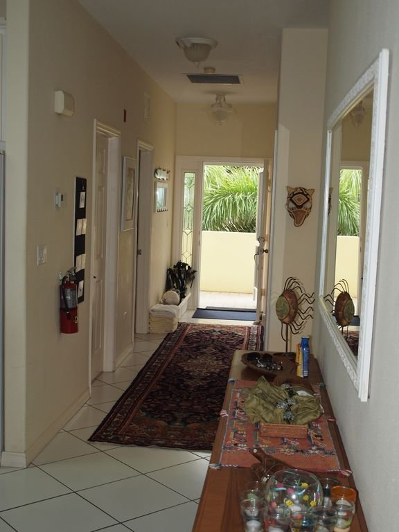 Entry hall with area for fins, masks and hooks along wall to hang your towels.