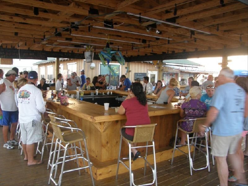 Enjoy a cold beverage and hot meal while overlooking beautiful Gulf of Mexico