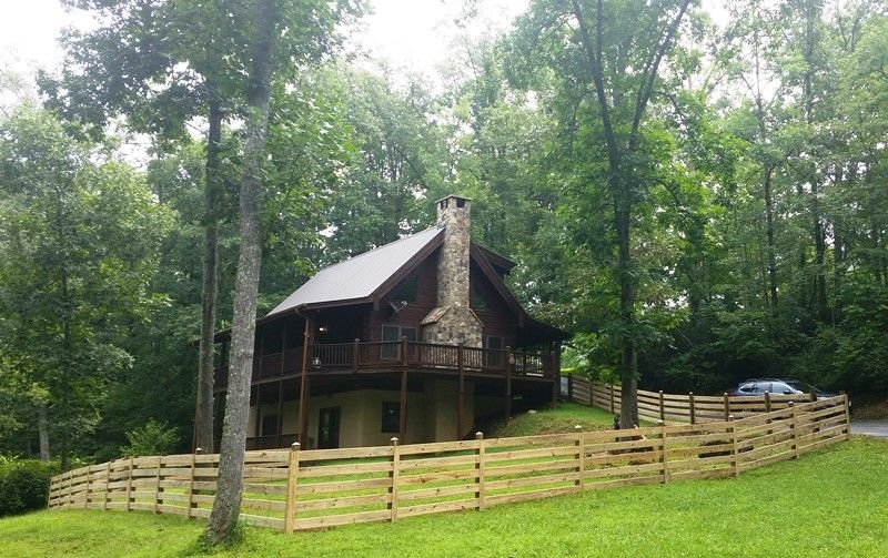 Cabin nestled in woods next to Big Brasstown Creek