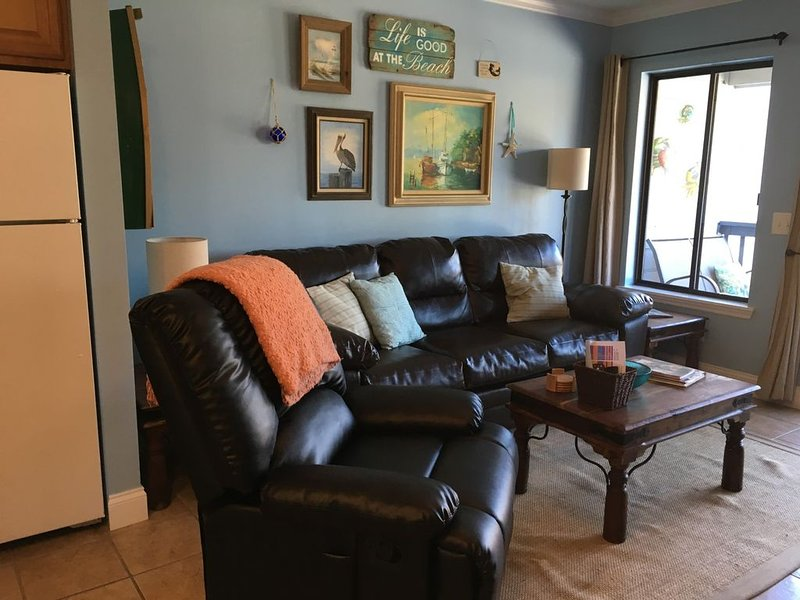seating area, sofa and recliner