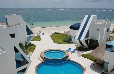 Oceanfront Luxury Townhome Condo Wifi 3 Plasma TV'S Pool & Spa, holiday rental in Puerto Morelos