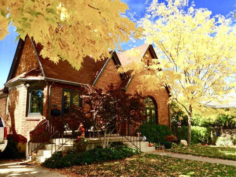 Front of this CHARMING Tudor style home in its full swing of FALL.