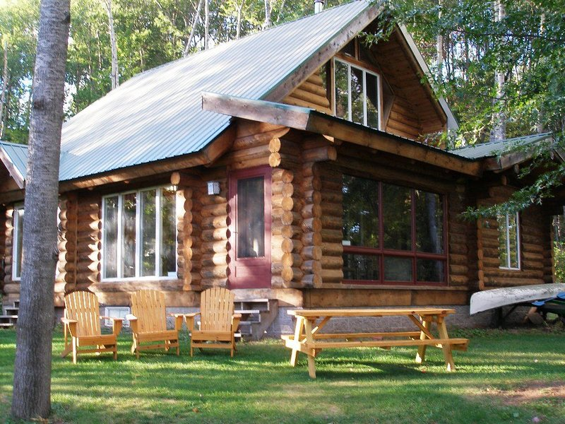 East Side of Cabin Facing Lake with Adirondack Chairs and Picnic Table