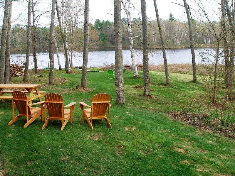 Gradual slope to the lake, adirondack chairs and picnic table