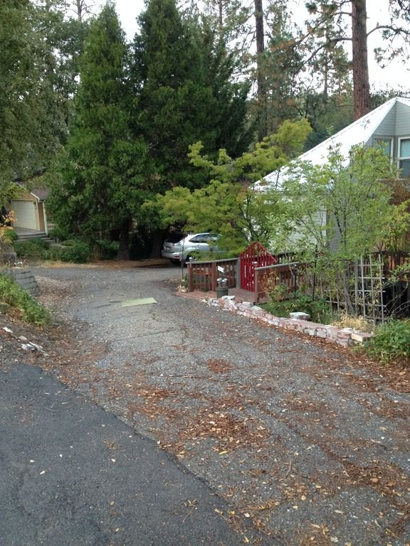 Driveway has room for 4-5 cars, but maneuvering can be difficult.