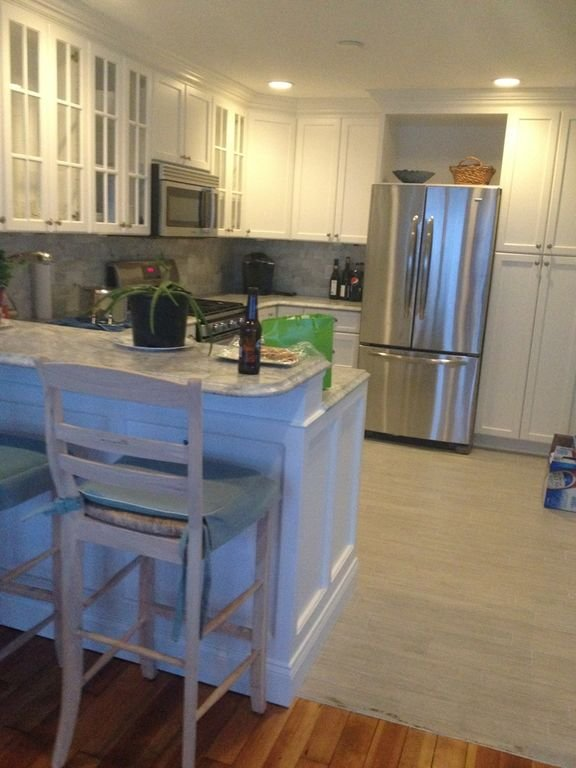 Brand new kitchen with stainless steel appliances including a dishwasher