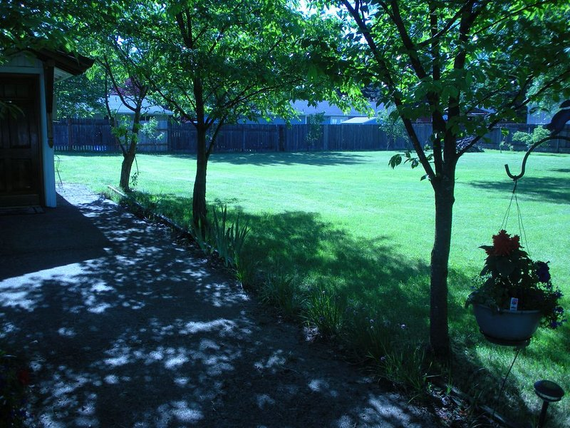 The Guest House sits on several acres of ground, surrounded by lush lawns.