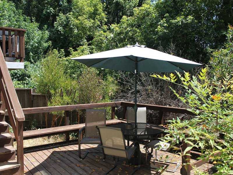 Back deck of Cottage #4;  Propane fired BBQ on upper deck off of the kitchen.