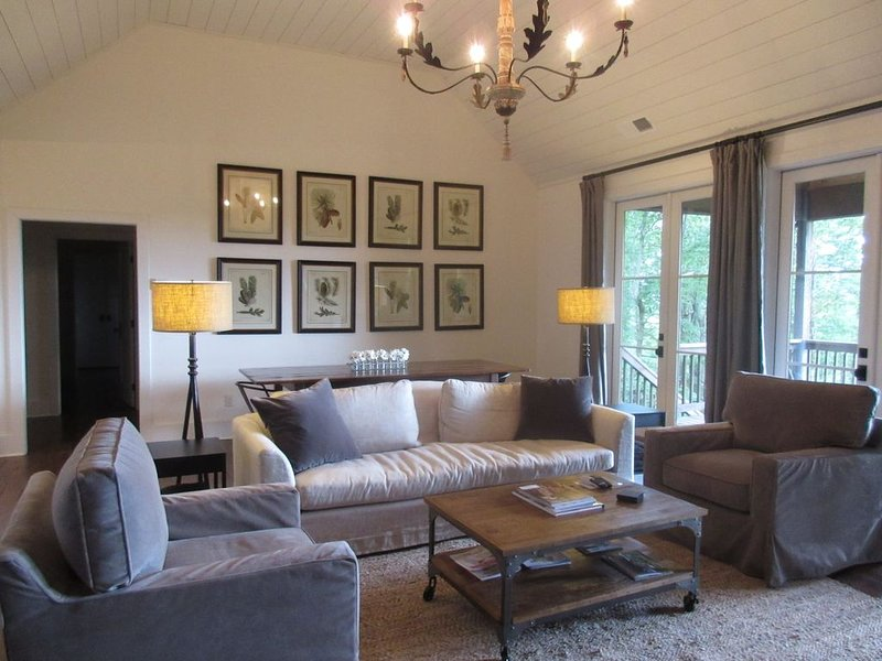 Spacious living room with vaulted ceiling, fireplace and view.