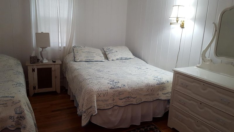 Bedroom with queen bed and a single & smart TV