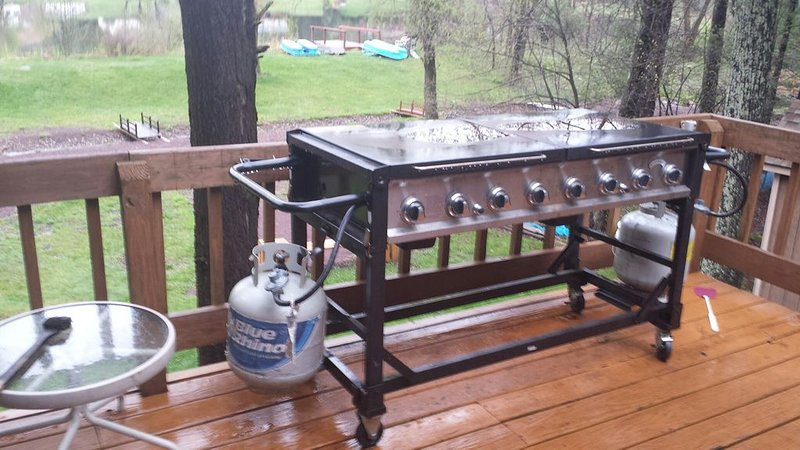 Large stainless grill on deck. We supply 2 propane tanks, too