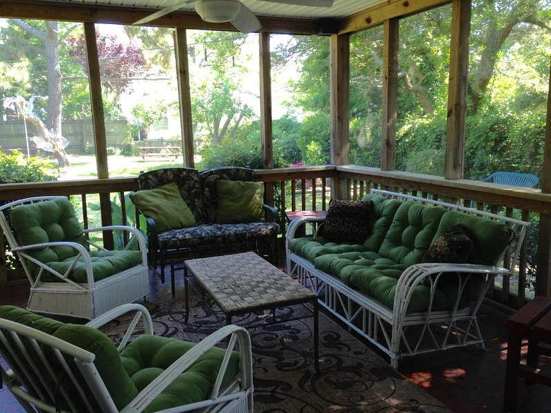 Screened in porch with sofa, loveseat and chairs