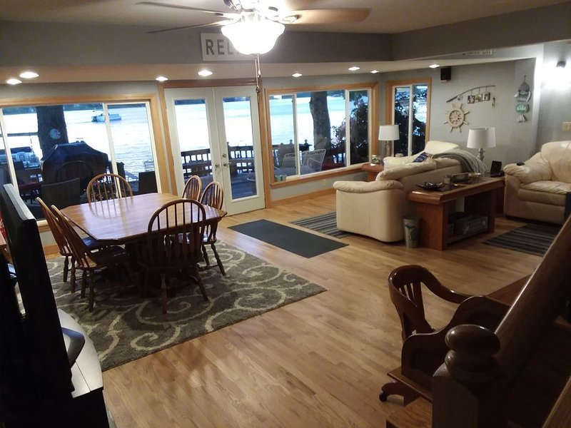 Main floor dining and open living room with majestic views of the lake.