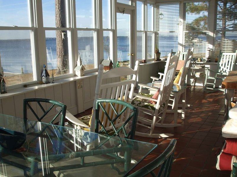 Magnificent porch - plenty of sun, breeze and view. with large table