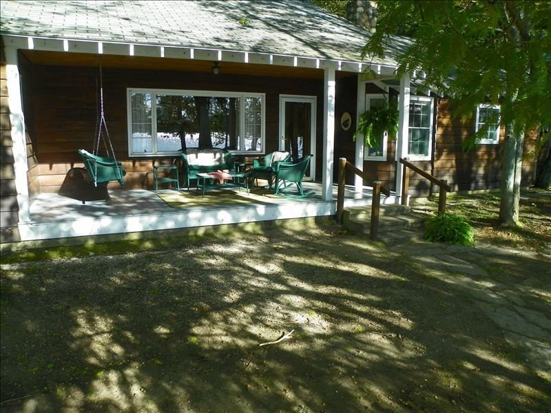 Lakeside front porch with swing