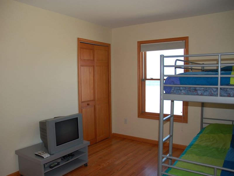 Bedroom on first floor with bunk beds and built in closet