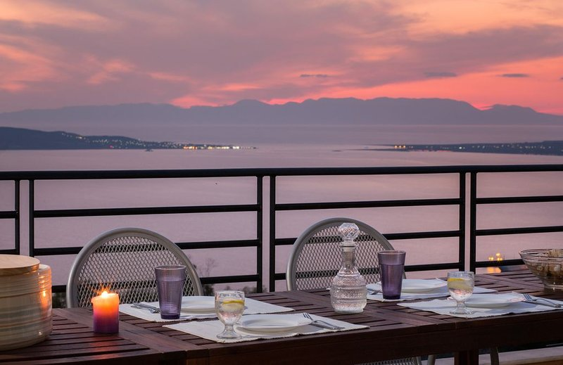 Candle-lit dinner with magnificent sunset view of the Neapolis gulf