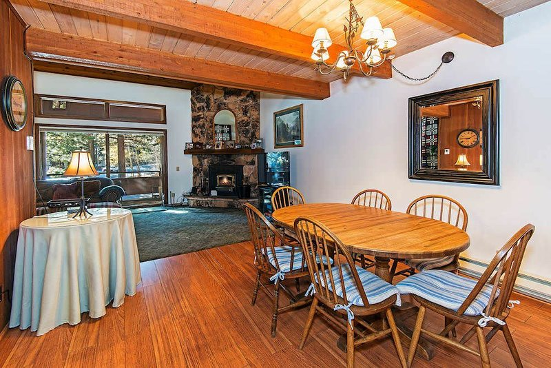 Living room w/ wood burning fireplace, board games, TV, DVD player
