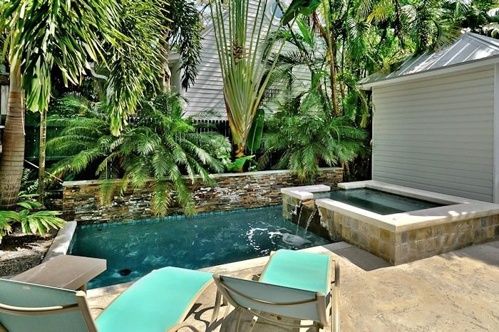 Community heated pool with loungers