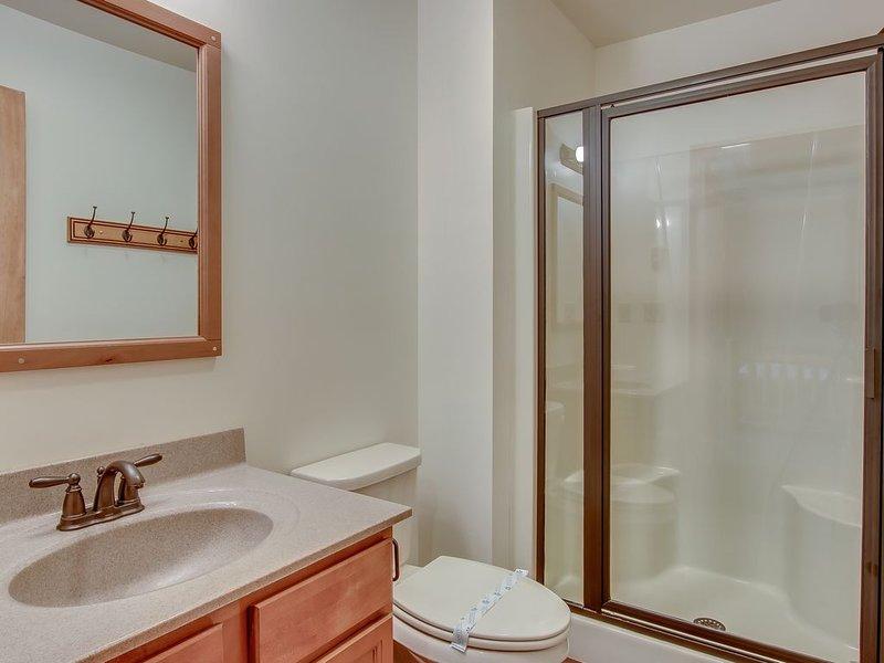Bathroom with Glass Door Shower, Toilet and Sink