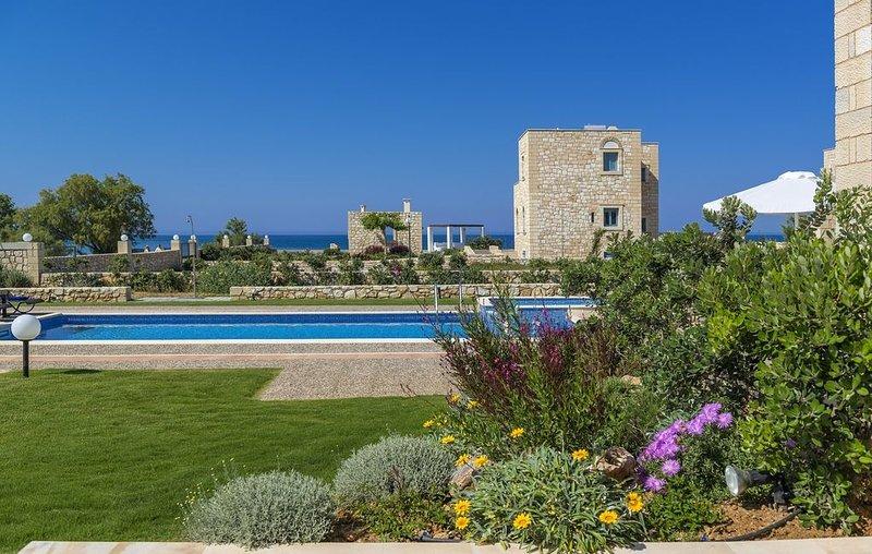 Elegant stone villa 70m from the beach, holiday rental in Afrata