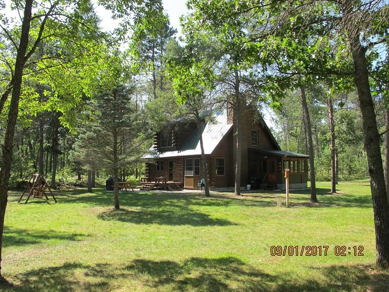 Tranquility Awaits YOU! - Log Cabin in the Woods on the Upper Boardman River, vacation rental in Grand Traverse County