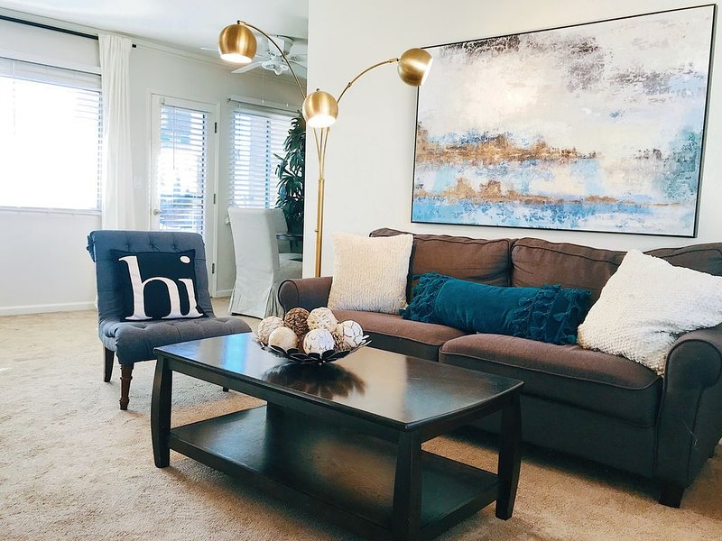 Spacious living room with views to the theater spire lights on Brand Blvd