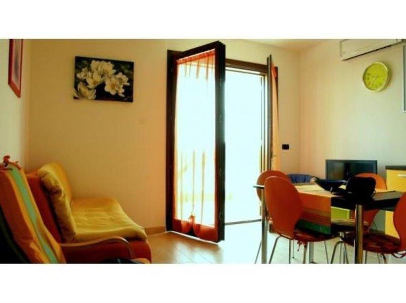 A meno di 300m dalla meravigliosa spiaggia di Maria Pia. Appartamento delizioso, location de vacances à Alghero