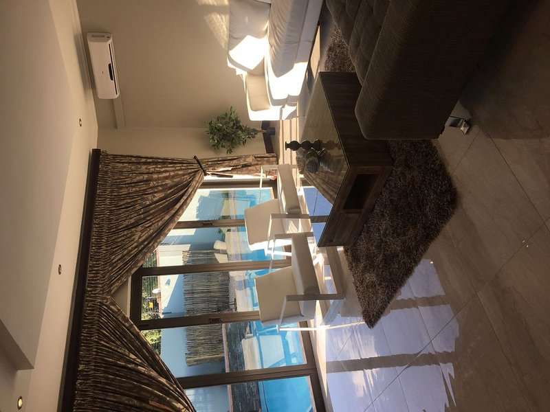 Ultra modern and luxurious self catering villa- safe and secure, central, holiday rental in Roodepoort