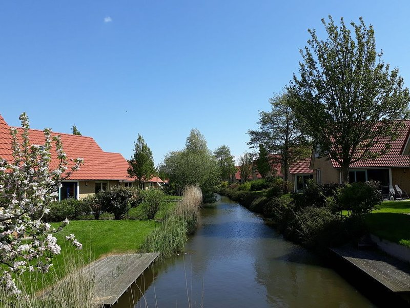 Detached holiday home with jetty, only 19 km. from Hoorn, vacation rental in Andijk