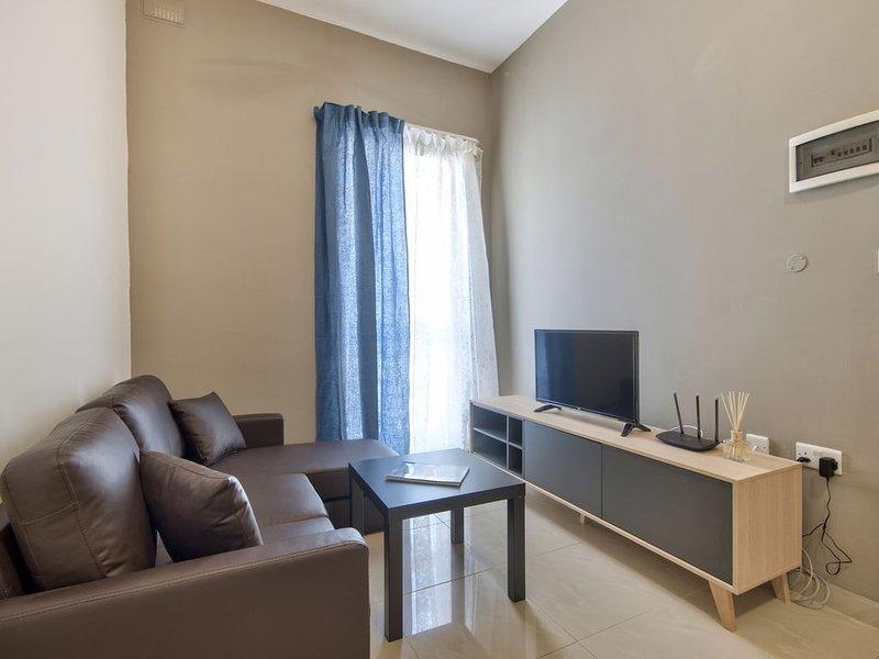 Modern 1-bedroom Apartment in Gzira, casa vacanza a San Gwann