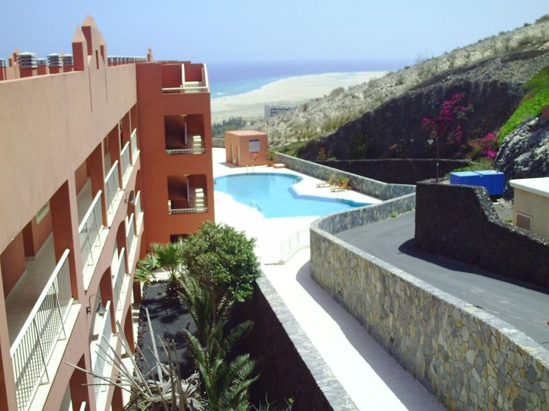 View of pool and panoramic view of the sea