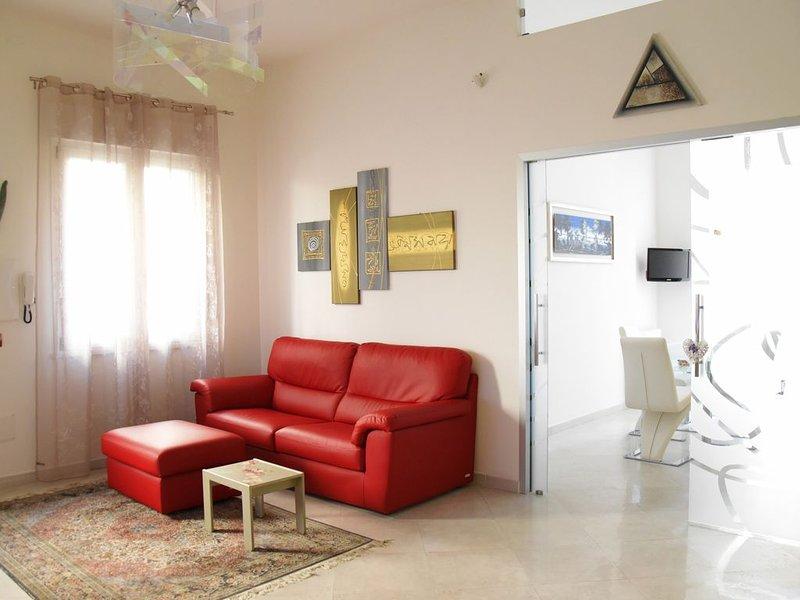 Appartamento con giardino in quartiere residenziale, a due passi dal mare, aluguéis de temporada em Cagliari