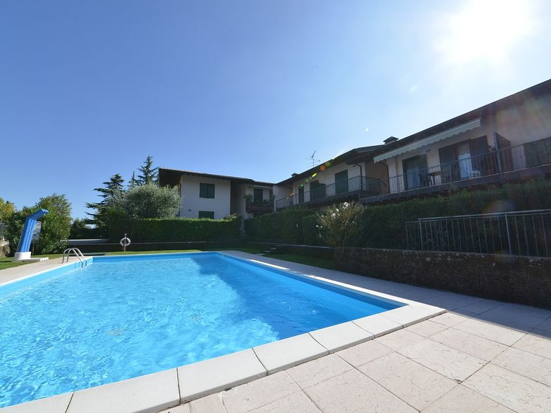 TRE SANTI Apparrtament con Piscina, holiday rental in Moniga del Garda