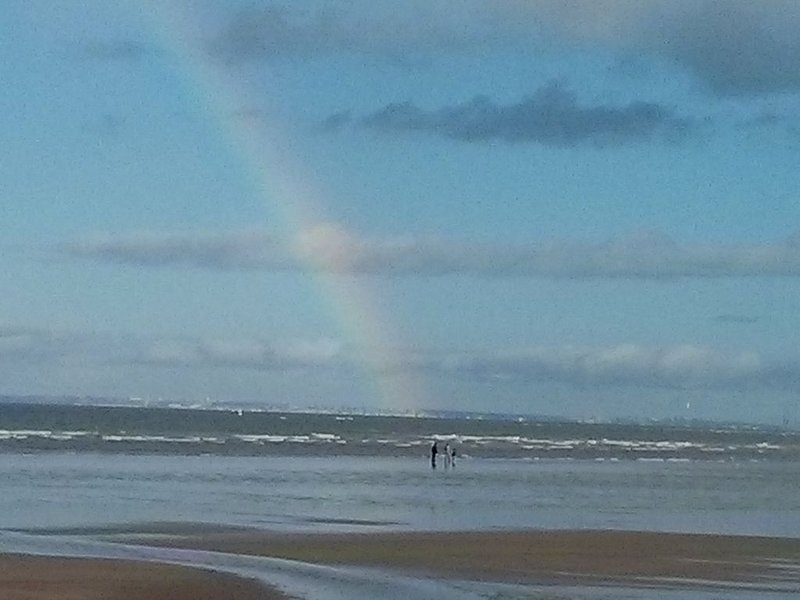 Rainbow on the large beach of Cabourg.