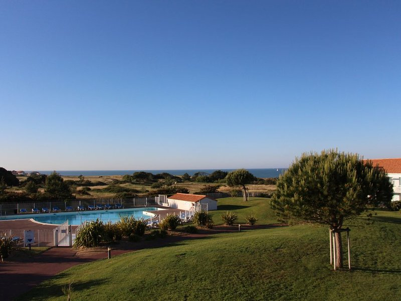 View from the balcony on pool and sea