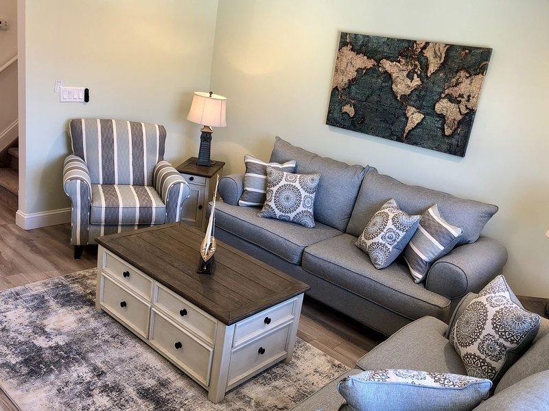 Sala familiar con sofá cama queen