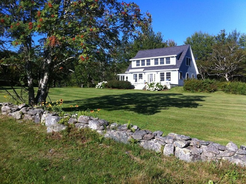 Charming Newbury Neck cottage set on many private wooded and oceanfront acres