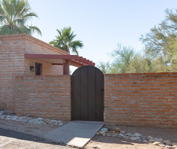 Private entrance to the Casita is through an iron gate