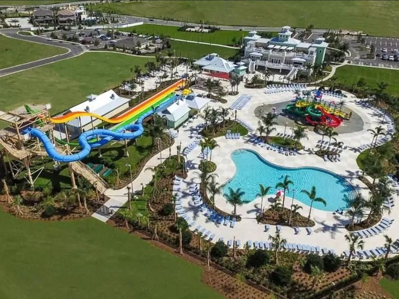 Encore Water Slide, Main Pool and Splash Pad located at the Club House